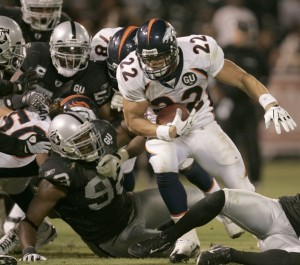 Denver Broncos fullback Peyton Hillis runs into a wall of Oakland Raiders defenders near the goal line during the fourth quarter of their NFL football game in Oakland, California September 8, 2008.  (REUTERS/Robert Galbraith)