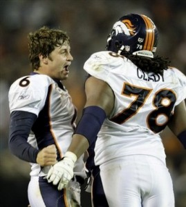 Jay Cutler and Ryan Clady (AP Photo)