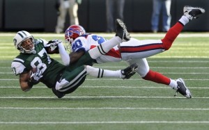 Donte Winter lays Laveranues Colees out during a play in the first quarter of the Buffalo Bills/New York Jets game (Ray Stubblebine- Reuters)