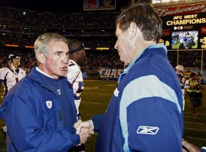 Mike Shanahan congratulates Norv Turner, following the Broncos final loss under Shanahan.