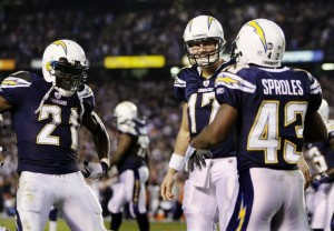 Philip Rivers and LaDainian Tomlinson congratulate Darren Sproles in the third quarter after a touchdown.