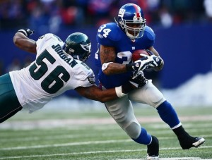 Derrick Ward runs past Akeem Jordan during the NFC Divisional Playoff Game. (Getty Images)