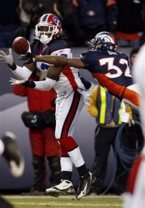 Steve Johnson pulls in a TD in front of Dre Bly on Sunday, Dec. 21, 2008. (AP Photo/David Zalubowski)