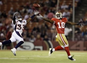 Denver Broncos cornerback Alphonso Smith (33) breaks up a pass intended for San Francisco 49ers wide receiver Micheal Spurlock (18) during their NFL preseason football game in San Francisco, Calif., Friday, Aug. 14, 2009. (AP Photo/Jeff Chiu)