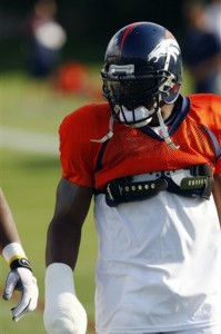 Denver Broncos safety Brian Dawkins, his broken hand wrapped in a cast, takes part in drills at the team's NFL football training camp on Monday, Aug. 17, 2009, in Englewood, Colo. (AP Photo/David Zalubowski)