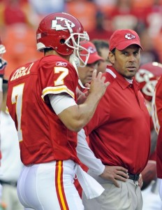 New Kansas City Chiefs starting quarterback Matt Cassel (L) talks with new head coach Todd Haley before their pre-season NFL football game against the Houston Texans at Arrowhead Stadium in Kansas City, Missouri August 15, 2009. (REUTERS/Dave Kaup)
