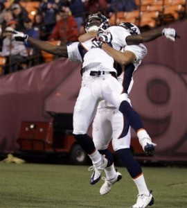Denver Broncos wide receiver Kenny McKinley (11) gets lifted off the ground by teammate Nate Swift after McKinley scored a touchdown in the fourth quarter during their NFL preseason football game in San Francisco, Calif., Friday, Aug. 14, 2009. (AP Photo/Jeff Chiu)