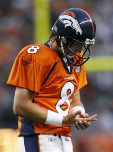 Denver Broncos quarterback Kyle Orton holds his right hand as he walks off of the field after being injured during an NFL preseason football game against the Chicago Bears in Denver on Sunday, Aug. 30, 2009. (AP Photo/Jack Dempsey )