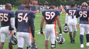 Denver Broncos linebackers walk out to practice.  (BroncoTalk/Kyle Montgomery)