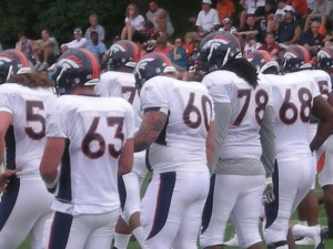 Denver Broncos offensive linemen run drills at training camp.  (BroncoTalk/Kyle Montgomery)