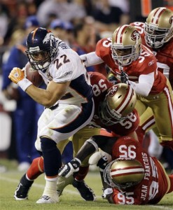 Denver Broncos' Peyton Hillis (22) runs against the San Francisco 49ers during the 2009 preseason.  (AP Photo/Jeff Chiu)