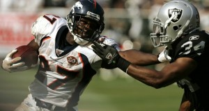 Denver Broncos running back Knowshon Moreno (L) runs against Oakland Raiders safety Mike Mitchell during the third quarter of their NFL football game in Oakland, California September 27, 2009. (REUTERS/Robert Galbraith)