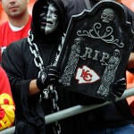 An Oakland Raiders fan holds a sign during the team's Week 2 game in Kansas City.  (Photo by Jamie Squire/Getty Images)