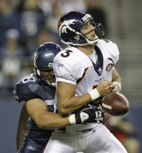 Seattle Seahawks' Nick Reed sacks Denver Broncos' quarterback Tom Brandstater in the fourth quarter Saturday, Aug. 22, 2009, in an NFL preseason football game in Seattle. (AP Photo/Elaine Thompson)