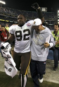 Denver Broncos linebacker Elvis Dumervil (92) celebrates with Broncos head coach Josh McDaniels after their victory over the San Diego Chargers in their Monday Night NFL football game in San Diego, California October 19, 2009. (REUTERS/Fred Greaves)