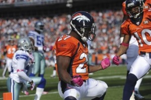 Denver Broncos running back Knowshon Moreno (27) celebrates a second quarter touchdown against the Dallas Cowboy during an NFL football game Sunday, Oct. 4, 2009, in Denver.  (AP Photo/Chris Schneider)