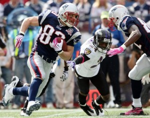 Wes Welker #83 of the New England Patriots carries the ball around Domonique Foxworth #24 of the Baltimore Ravens on October 4, 2009 at Gillette Stadium in Foxboro, Massachusetts.  (Photo by Elsa/Getty Images)