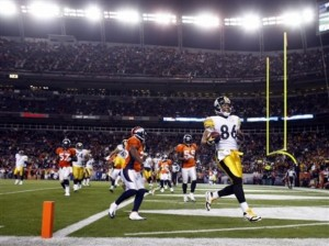 Hines Ward celebrates after catching a pass for a touchdown against the Denver Broncos during the fourth quarter of the Steelers' 28-10 victory in an NFL football game Monday, Nov. 9, 2009, in Denver. (AP Photo/David Zalubowski)