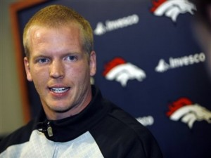Denver Broncos quarterback Chris Simms talks to the media in April 2009. (AP Photo/David Zalubowski)
