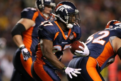 Running back Knowshon Moreno #27 of the Denver Broncos rushes against the New York Giants during NFL action at Invesco Field at Mile High on November 26, 2009 in Denver, Colorado.  (Doug Pensinger/Getty Images)