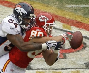Denver Broncos linebacker Andra Davis (54) breaks up a pass intended for Kansas City Chiefs wide receiver Bobby Wade (80) during the first quarter of an NFL football game Sunday, Dec. 6, 2009 in Kansas City, Mo. (AP Photo/Charlie Riedel)