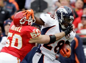 Correll Buckhalter #28 of the Denver carries the ball as Mike Vrabel #50 of the Kansas City Chiefs defends during the game on December 6, 2009 at Arrowhead Stadium in Kansas City, Missouri.  (Jamie Squire/Getty Images)