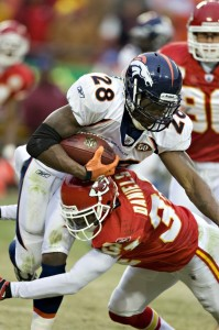 Correll Buckhalter #28 of the Denver Broncos is tackled by Travis Daniels #34 of the Kansas City Chiefs on December 6, 2009 in Kansas City, Missouri.  The Broncos defeated the Chiefs 44-13.  (Wesley Hitt/Getty Images)
