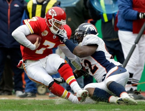 Quarterback Matt Cassel #7 of the Kansas City Chiefs is sacked by Elvis Dumervil #92 of the Denver Broncos during the game on December 6, 2009 at Arrowhead Stadium in Kansas City, Missouri.  (Jamie Squire/Getty Images)