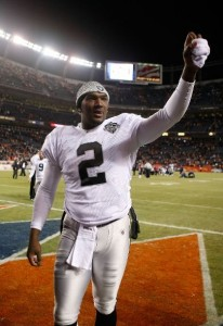 Quarterback JaMarcus Russell #2 celebrates following the Oakland Raiders' victory over the Denver Broncos at Invesco Field at Mile High on December 20, 2009 in D
