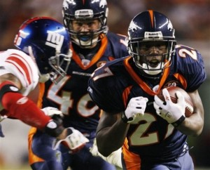 Denver Broncos running back Knowshon Moreno, right, runs before a tackle by New York Giants safety Michael Johnson, left, during the first quarter of an NFL football game in Denver, Thursday, Nov. 26, 2009. (AP Photo/Jack Dempsey)
