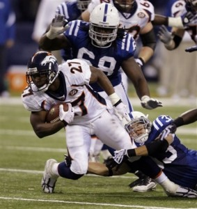 Denver Broncos running back Knowshon Moren, left, is tackled by Indianapolis Colts cornerback Melvin Bullitt in the third quarter of an NFL football game in Indianapolis, Sunday, Dec. 13, 2009. The Colts defeated the Broncos 28-16. (AP Photo/Michael Conroy)