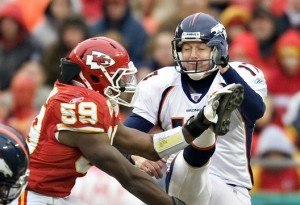 Jovan Belcher #59 of the Kansas City Chiefs just touches the foot of punter Mitch Berger #17 of the Denver Broncos for a interference penalty on December 6, 2009 in Kansas City, Missouri.  The Broncos defeated the Chiefs 44-13.  (Photo by Wesley Hitt/Getty Images)
