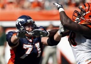 Denver Broncos offensive lineman Russ Hochstein (71) blocks Cincinnati Bengals defensive end Antwan Odom (98) in Cincinnati in 2009. (AP Photo/Ed Reinke)