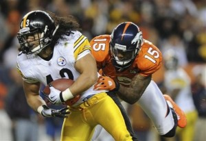 Brandon Marshall tackles Troy Polamalu after Polamalu intercepted a pass by Kyle Orton. (AP Photo/Chris Schneider)