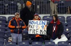 A Broncos fan holds a sign expressing his sentiments about head coach Josh McDaniels. (Photo by Doug Pensinger/Getty Images)
