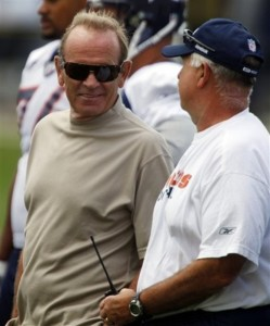 Broncos owner Pat Bowlen, jokes with head trainer Steve Antonopulos during drills in training camp in Aug
