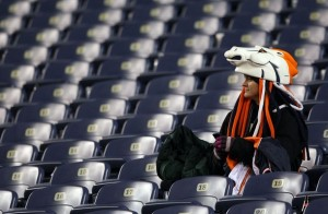 A Broncos fan sits in the seats following the Denver Broncos defeat by the Kansas City Chiefs on January 3, 2010. (Photo by Doug Pensinger/Getty Images)