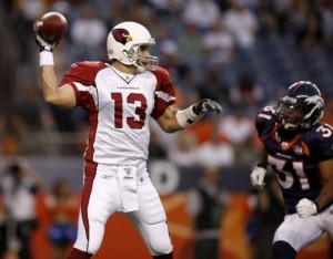 Darcel McBath applies pressure to Kurt Warner during a 2009 preseason game (AP Photo/ David Zalubowski).