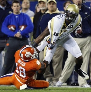 Demaryius Thomas breaks a tackle follwing a reception in the ACC Championship game. (AP Photo/Mike Carlson)