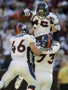 Brandon Marshall celebrates a touchdown with Spencer Larsen and Chris Kuper. (AP Photo/Nick Wass)