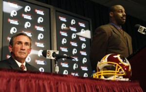 Donovan McNabb listens during a press conference with Redskins head coach Mike Shanahan. (REUTERS/Molly Riley)