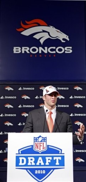 Tim Tebow responds to questions during his first press conference at Dove Valley. (AP Photo/Ed Andrieski)