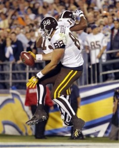 Tony Scheffler celebrates a touchdown with Eddie Royal in 2009. (AP Photo/Denis Poroy)
