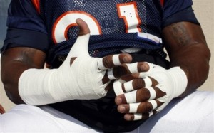 Ronald Fields completes his ritual of taping his hands up before taking place in drills during 2009's training camp. (AP Photo David Zalubowski)