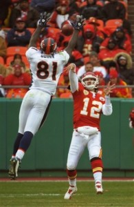 Richard Quinn blocks a Brodie Croyle pass at the start of the second half of the Broncos vs. Chiefs. (AP Photo/Reed Hoffmann)