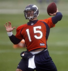 Tim Tebow takes part in drills during Broncos minicamp at Dove Valley in June. (AP Photo/David Zalubowski)