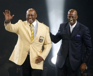Floyd Little and his presenter, son Marc Little, are introduced at the Pro Football Hall of Fame.  (AP Photo/Scott Heckel)