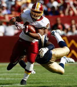 Ladell Betts runs through Justin King of the St. Louis Rams in 2009. (Photo by Win McNamee/Getty Images)