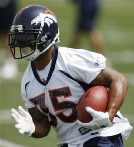 Lance Ball runs during practice at Dove Valley. (AP Photo/David Zalubowski)