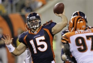 Tim Tebow passes against the Bengals. (AP Photo/Ed Reinke)